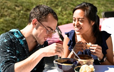 Tom Badman and Michelle Blankas, couple from Syracuse, enjoy their soup choices at Empty Bowls Project of Syracuse fundraiser, 2014.