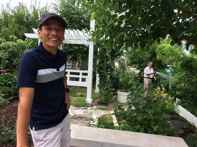 Dai-Duong Ton-That and his father, Nhuan, in their garden in Syracuse.
