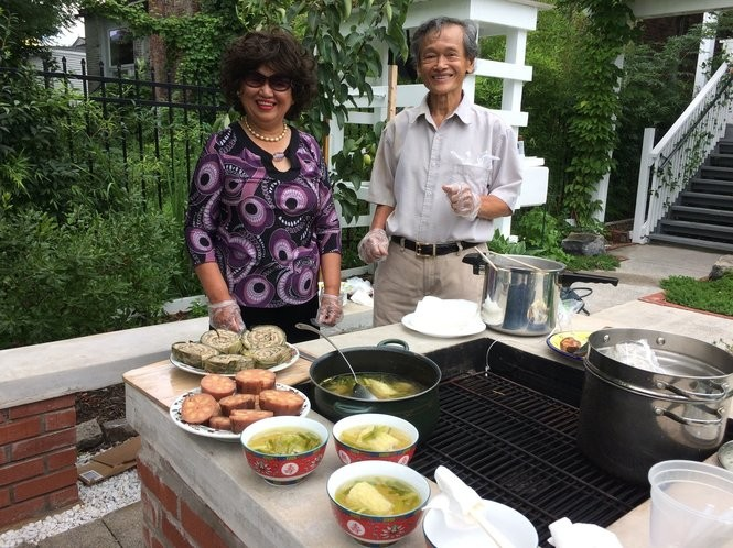 Lien-hoa and Nhuan Ton-That in their family garden in Syracuse.