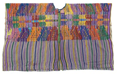 Fewer Maya wear their traditional dress, such as this woman's huipil or blouse. The reasons are both political and social: the Guatemalan civil war killed 170,000 Mayas and globalization brought cheaper, international clothing brands into the country.