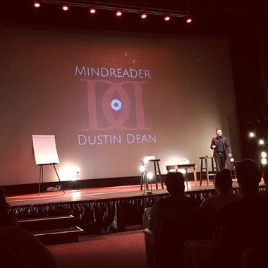 Dustin Dean performs on stage.