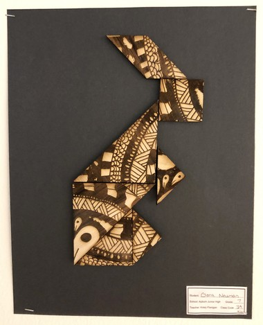 """Students in each Auburn Junior High School seventh-grade art class class voted on the best tangram, and that work was etched into wood for display at """"Both Ends of the Rainbow."""""""