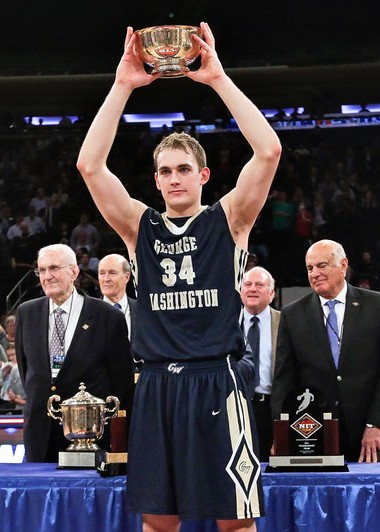 George Washington's Tyler Cavanaugh poses for photographs while holding the Most Outstanding Player trophy after the team's NCAA college basketball game against Valparaiso in the final of the NIT on Thursday, March 31, 2016, in New York. George Washington won 76-60.