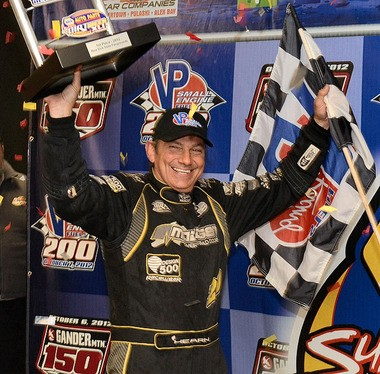 Brett Hearn celebrates after winning the rain-shortened VP Small Engine Fuels 200 at the New York State Fairgrounds on Oct. 7, 2012.