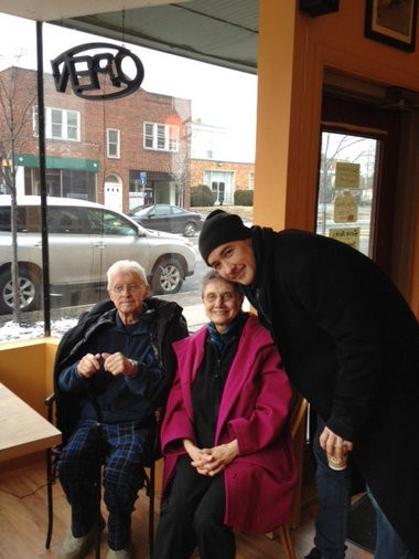 "John Cusack posted this photo on Twitter of himself with Syracuse activist Jerry Berrigan and his wife Carol in 2012. The actor plays a poet/professor in ""Adult World,"" an independent movie filming in the area at the time."