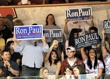 Ron Paul supporters raise their signs for the GOP presidential candidate in Lynah Rink on the Cornell University campus in 2012.
