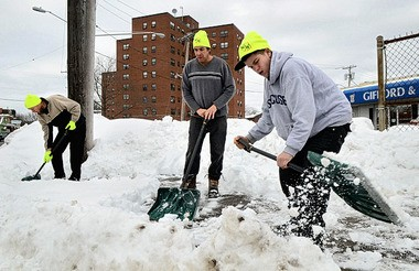 The Westside Residents Coalition has begun a new initiative called Westside Walks to shovel sidewalks in high traffic areas where absentee landlords and the city have not cleared snow. Working at the corner of Gifford St. and West St. are L-R; Ted Bauer, Gary Bonaparte, and Artie Gilchrist.