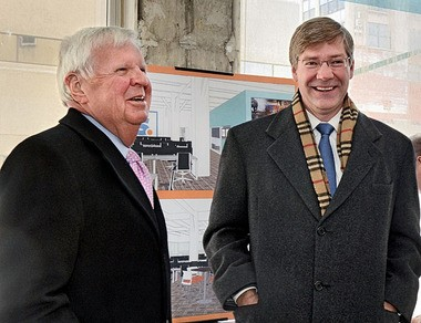 Stephen A. Rogers (left) and Tim Kennedy, chairman and president respectively of Syracuse Media Group, discuss the company's planned move at a news conference Friday.