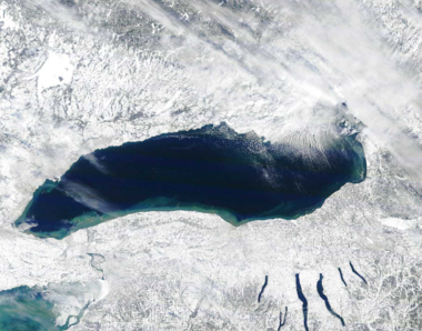 Lake effect snow is created when cold winds blow over warmer, relatively open lakes such as Lake Ontario. Unlike the other Great Lakes, Ontario stays mostly unfrozen in winter, which helps create lake effect snow in Central New York and Tug Hill.