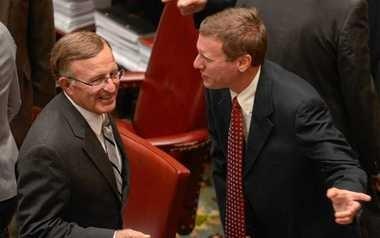 State Sen. David Valesky talks with Sen. John DeFrancisco before the start of a legislative session last June.