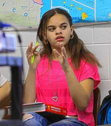 Keionia Torrance makes a point in Rich Richardson's social studies class at the Expeditionary Learning Middle School.