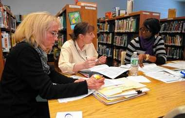 Carol Marshall, left, Nancy Taffner, center, and Nadine Malcolm of the Syracuse school district attend a training session for teachers and officials at Delaware Elementary last year to learn new teacher evaluation standards.
