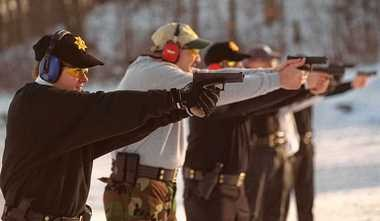 Sheriff's deputies (from Onondaga & Cayuga counties) practice handling firearms at the Elbridge Rod and Gun Club in this 2000 photo. They are using 45 caliber Glock pistols.