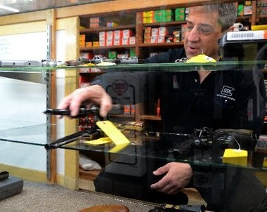 David Steinberg of Ra-Lin's moves a Ruger Security Six handgun in a normally packed case on Sunday.