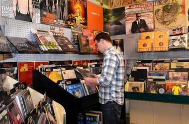"""Ryan Hasto, of Syracuse, looks through the used vinyl records at The Sound Garden in Armory Square. """"They have every genre of music,"""" he said."""
