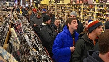 Customers cram the aisles of The Sound Garden Saturday during national Record Store Day.