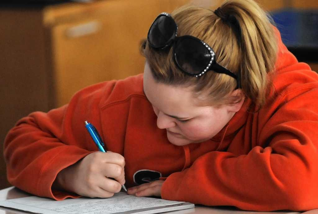 Michelle Diegoli, an 11th-grader at Nottingham High School in Syracuse, takes a test in this March photo.