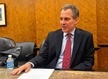 Attorney General Eric Schneiderman at a meeting of the Syracuse Media Group's editorial board on June 25, 2013.