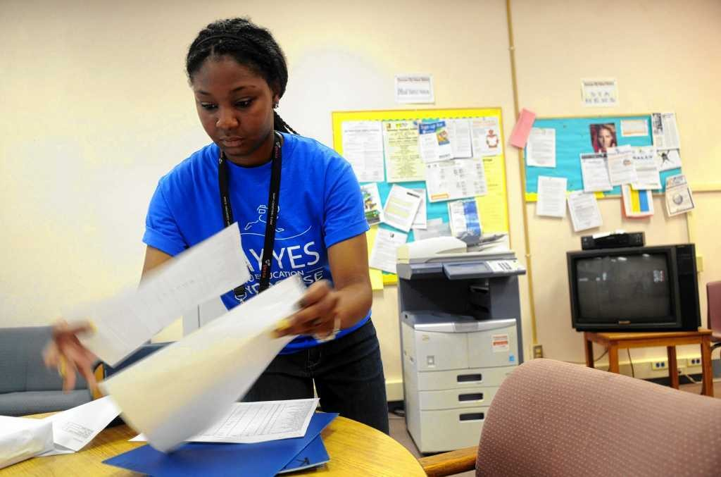 Arielle Kaigler-Hall, who is attending Medaille College on a Say Yes scholarship, makes copies of class lists for the Say Yes summer camp at Franklin Elementary School, where she is working this summer.