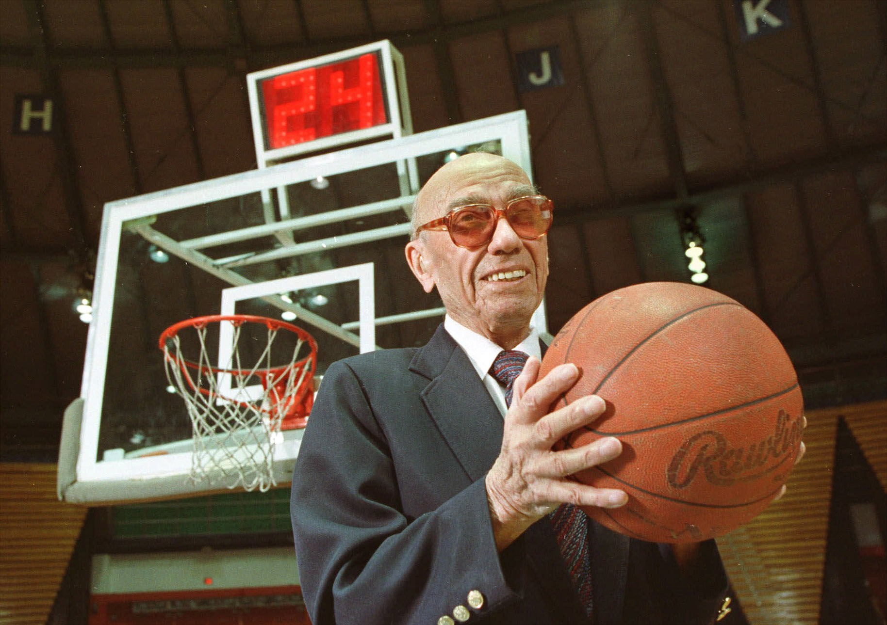 The late Danny Biasone, an innovator of the NBA's 24-second shot clock, is shown in this March 8, 1992 photograph at a gym at Syracuse University.