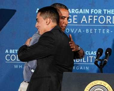 President Barack Obama hugs Corcoran High School senior Emilio Ortiz after Ortiz introduces him at Henninger High School.