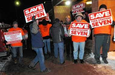 Syracuse firefighters demonstrate their support for Fire Station No. 7 outside Mayor Stephanie Miner's State of the City Address Jan. 24 at Dr. Weeks Elementary School in Syracuse. Miner closed the station in May and reduced firefighter staffing levels.