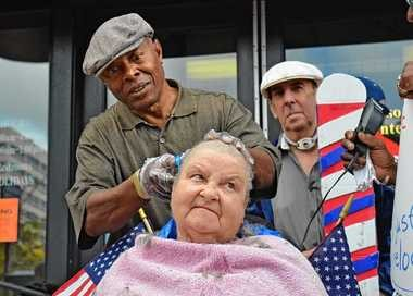 Sue Hoillister gets her head shaved by James Shields on Sept. 28, 2011, in front of the Ida Benderson Senior Center in Syracuse. Hollister and two other center participants shaved their heads to protest the center's closing.