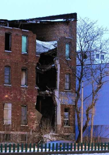 This building at 921-925 N. State St., shown in a Feb. 26. 2010 photo, was demolished in March 2010 after bricks from it fell near the shoulder of nearby Interstate 81. Mayor Stephanie Miner got the state to pay most of the cost of demolition.