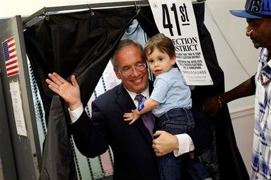 Manhattan Borough President Scott Stringer emerges from a voting booth with his 20-month old son Max after casting his ballot during the primary election, Tuesday, Sept. 10, 2013, in New York.