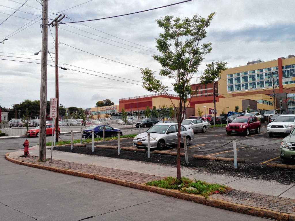 Developer Cosimo Zavaglia has proposed building a mixed-used building with 24 apartments on this parking lot at the corner of Butternut Street and Prospect Avenue in Syracuse. St. Joseph's Hospital Health Center is in the background.