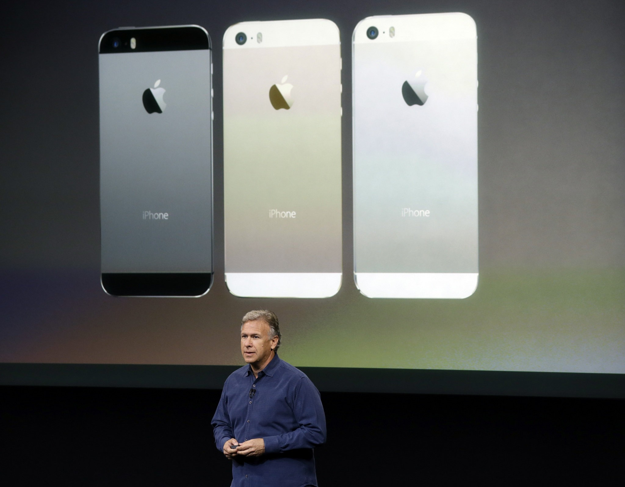 Phil Schiller, Apple's senior vice president of worldwide product marketing, speaks on stage during the introduction of the new iPhone 5s in Cupertino, Calif., Tuesday, Sept. 10, 2013.