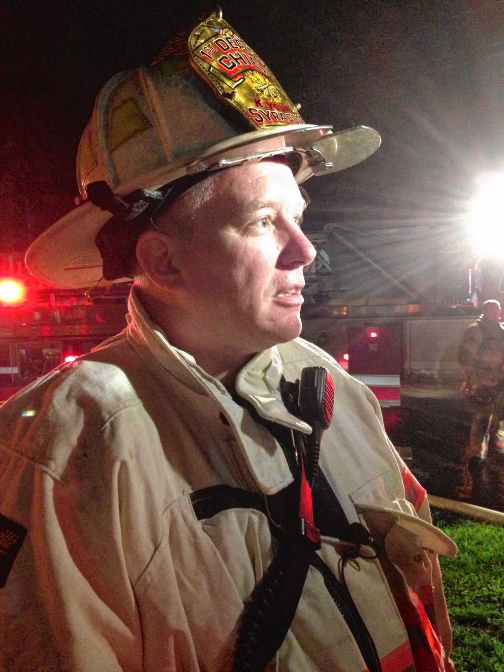Syracuse First Deputy Fire Chief Kent Young talks to the media Monday night about the fire at Grace Episcopal Church in Syracuse.
