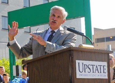 Dr, David R. Smith at a ceremony in 2011 marking Upstate's acquisition of Community General Hospital.