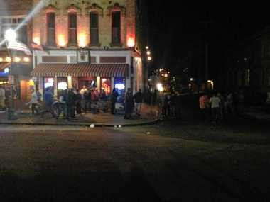 """Police officers maintain a heavy presence in downtown Cortland Saturday night after dozens were arrested during """"Cortaca"""" celebrations."""
