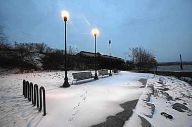 """The northern end of the Onondaga Creekwalk in Syracuse is covered with a light snow early Friday morning. The city plans to create a """"lake lounge"""" with tiered decking, seating and enhanced lighting to expand public access to the area, which overlooks Onondaga Lake."""
