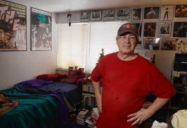 Bill Wilkinson makes $7.50 an hour at the Varsity near Syracuse University. Wilkinson is one of many low-wage earners who will benefit from end of year increase to $8 per hour. Wilkinson poses in his Syracuse apartment.