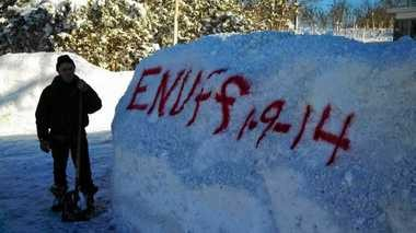 Rob Parsons, of the Jefferson County village of Adams, spray-painted a message on the snowbank in front of his house after several feet of lake effect snow fell in January.
