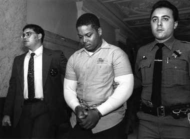 Robert Lawrence Jr., left, accused in the shooting death of Syracuse Police officer Wallie Howard Jr., is led down the hall in the Onondaga County Courthouse on Nov. 9, 1990. Escorting him were Deputies Anthony Callisto and John D'Eredita.