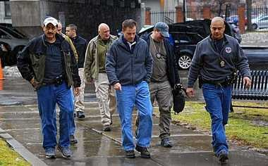 "Members of the Syracuse Police Department approach the U.S. District Court in Utica, N.Y. on Tuesday Jan. 14, 2014 to see convicted cop-killer Robert ""Bam Bam"" Lawrence ask a judge to reduce his sentence for murdering undercover Syracuse Police narcotics investigator Wallie Howard Jr. in 1990."