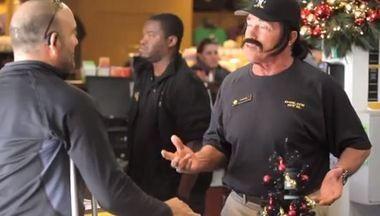 8f5c372d871af Former California governor Arnold Schwarzeneggwer advises a member at a  Gold s Gym during a prank promoting