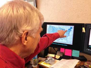 Syracuse University geography professor Mark Monmonier points to an old map showing the lake effect snow areas east of Lake Ontario. Monmonier used the map for his book on lake effect snow.