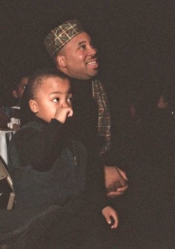 Kilpatrick and his son listen to Mary Francis Berry of the U.S. Civil Rights Commission in the Carrier Dome in 1997. (File photo)