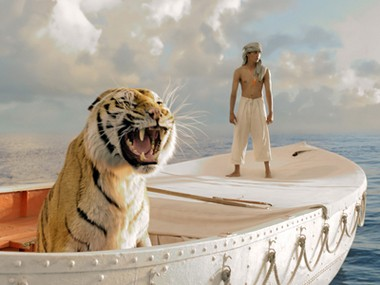 """Pi Patel on a lifeboat with a tiger in """"Life of Pi."""""""