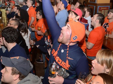 Syracuse student Bryan Wilbur cheers at Faegan's during Syracuse University's matchup with Marquette last March.
