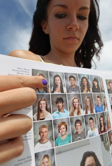 Wasatch High School sophomore Kimberly Montoya, 16, points to her altered school yearbook photo, Thursday, May 29, 2014, in Heber City, Utah.