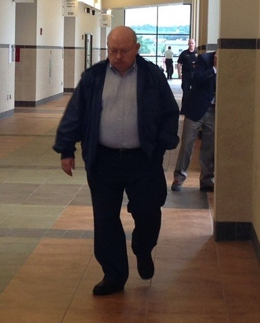 Robert Ours leaves County Court in Syracuse.