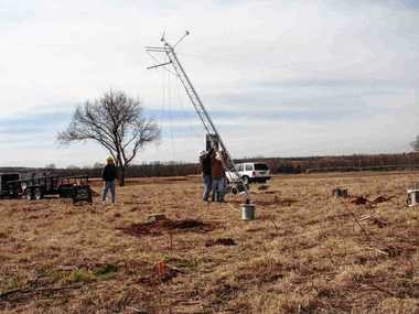 Work crews in Oklahoma install one of the state's 120 weather stations. New York wants to build a $23.6 million weather detection system similar to Oklahoma's.