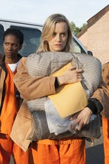 """Taylor Schilling in a scene from """"Orange is the New Black."""" The orange-colored uniforms gained popularity in jail and in public after the show's release on Netflix."""