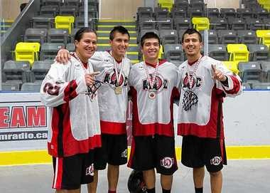 Brothers (from left to right) Haina, Lyle, Miles and Jeremy Thompson take a photo Sunday after the Onondaga Redhawks won the Presidents' Cup in box lacrosse.