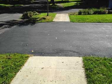 After Syracuse couple spends $1,000 on new driveway, city